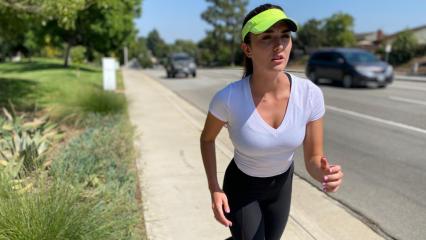 Female running on side of road