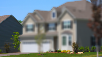 A blurred image of a home in a residential area.