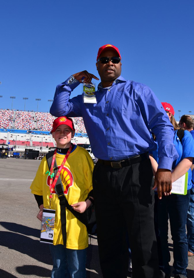 Todd Smith with a student at the raceway