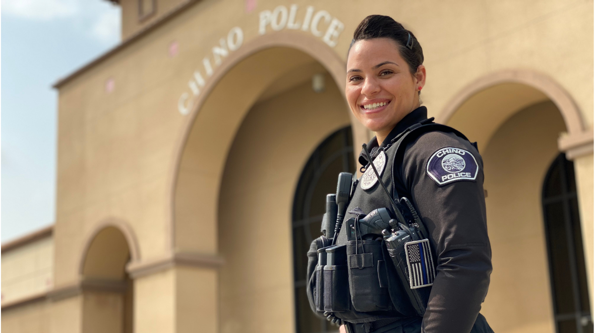 Chino Police Officer Jessica Asbee posing in front of the Chino Police Department.