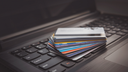 Credit cards piled up on a laptop keyboard