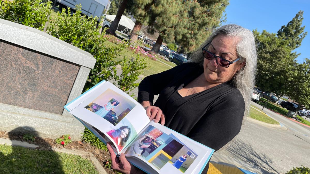 Delissa Steele holding photo book